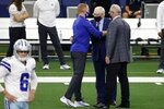 Dallas Cowboys team owner Jerry Jones, center, and Stephen Jones, right, greet New York Giants offensive coordinator Jason Garrett, left, before an NFL football game in Arlington, Texas, Sunday, Oct. 11, 2020. The game marks the first time Garrett has returned to play against the team he was the head coach of last season. (AP Photo/Ron Jenkins)