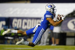 BYU wide receiver Gunner Romney makes a catch during the first half of the team's NCAA college football game against Troy on Saturday, Sept. 26, 2020, in Provo, Utah. (AP Photo/Rick Bowmer, Pool)