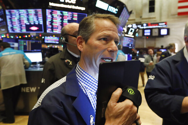 FILE - In this Friday, Dec. 13, 2019, file photo trader Robert Charmak works on the floor of the New York Stock Exchange. Stocks are opening higher on Wall Street on Monday, Dec. 16, following gains overseas as China reported encouraging news on its economy. (AP Photo/Richard Drew, File)