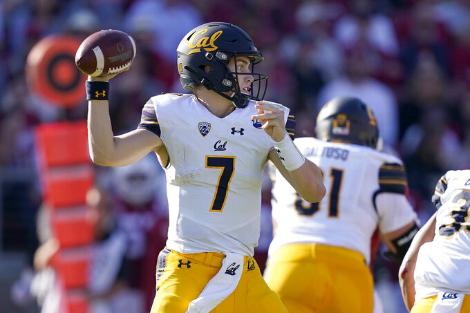 California quarterback Chase Garbers (7) passes against Stanford during the first half of an NCAA college football game Saturday, Nov. 23, 2019 in Stanford, Calif. (AP Photo/Tony Avelar)