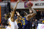 West Virginia guard Kedrian Johnson (0) goes to the basket in front of Oklahoma State guard Rondel Walker (5) in the first half of an NCAA college basketball game Monday, Jan. 4, 2021, in Stillwater, Okla. (AP Photo/Sue Ogrocki)