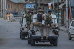 Indian policemen ride armoured vehicles after dispersing Kashmiri protesters during day-long security restrictions in Srinagar, Indian controlled Kashmir, Friday, Sept. 3, 2021. Indian authorities enforced a security lockdown and a near-total communications blackout for a second straight day in disputed Kashmir on Friday after the death of Syed Ali Geelani, a top resistance leader who became the emblem of the region's defiance against New Delhi. (AP Photo/Dar Yasin)