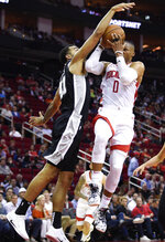 Houston Rockets guard Russell Westbrook (0) drives to the basket as San Antonio Spurs forward Trey Lyles defends during the first half of an NBA preseason basketball game Wednesday, Oct. 16, 2019, in Houston. (AP Photo/Eric Christian Smith)