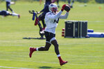 New England Patriots wide receiver Mohamed Sanu Sr. makes a catch during an NFL football training camp practice, Sunday, Aug. 23, 2020, in Foxborough, Mass. (AP Photo/Steven Senne, Pool)