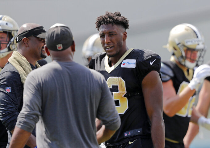 New Orleans Saints wide receiver Michael Thomas talks to wide receivers coach Curtis Johnson during training camp at their NFL football training facility in Metairie, La., Thursday, Aug. 1, 2019. (AP Photo/Gerald Herbert)