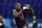 LSU linebacker Michael Divinity runs a drill at the NFL football scouting combine in Indianapolis, Saturday, Feb. 29, 2020. (AP Photo/Michael Conroy)