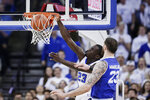 Creighton's Damien Jefferson, rear, dunks against Seton Hall's Sandro Mamukelashvili (23) during the first half of an NCAA college basketball game in Omaha, Neb., Saturday, March 7, 2020. (AP Photo/Nati Harnik)