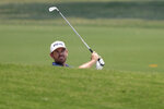 South Africa's Louis Oosthuizen plays from a bunker on the 5th hole during the opening round of the Australian Open golf tournament in Sydney, Thursday, Dec. 5, 2019. (AP Photo/Rick Rycroft)