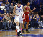 Kentucky's Tyler Herro (14) and Arkansas' Jalen Harris (5) react after a play during the second half of an NCAA college basketball game in Lexington, Ky., Tuesday, Feb. 26, 2019. Kentucky won 70-66. (AP Photo/James Crisp)