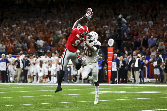 Georgia wide receiver Jeremiah Holloman (9) tries in vain to pull in a pass reception as Texas defensive back Davante Davis (18) covers during the first half of the Sugar Bowl NCAA college football game in New Orleans, Tuesday, Jan. 1, 2019. (AP Photo/Rusty Costanza)