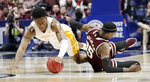 Tennessee guard Admiral Schofield, left, and Mississippi State forward Aric Holman (35) dive for a loose ball in the second half of an NCAA college basketball game at the Southeastern Conference tournament Friday, March 15, 2019, in Nashville, Tenn. Tennessee won 83-76. (AP Photo/Mark Humphrey)