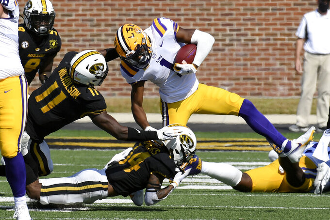 LSU wide receiver Kayshon Boutte (1) runs with the ball as Missouri linebacker Devin Nicholson (11) and defensive back Adam Sparks (14) defend during the first half of an NCAA college football game Saturday, Oct. 10, 2020, in Columbia, Mo. (AP Photo/L.G. Patterson)