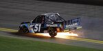 Christian Eckes (51) catches fire during a NASCAR Truck Series auto race Friday, Feb. 15, 2019, at Daytona International Speedway in Daytona Beach, Fla. Eckes was able to get out of the vehicle. (AP Photo/Chris O'Meara)