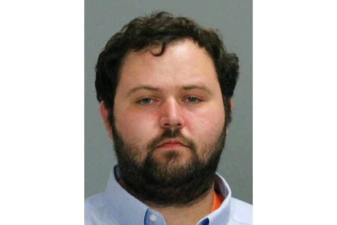 This Thursday, April 8, 2021, booking photo provided by the Bryan Police Department in Texas shows Larry Winston Bollin. Authorities say Bollin opened fire Thursday at a Texas cabinet-making company where he worked, killing one person and wounding others before shooting and wounding a state trooper prior his arrest. (Bryan Police Department via AP)