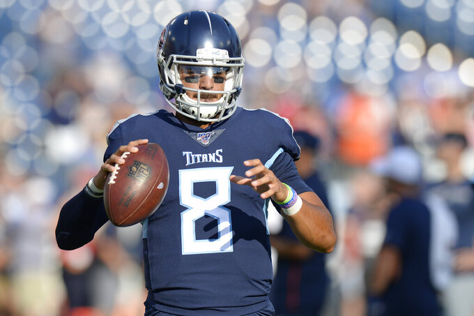 Tennessee Titans quarterback Marcus Mariota warms up before a preseason NFL football game against the New England Patriots Saturday, Aug. 17, 2019, in Nashville, Tenn. (AP Photo/Mark Zaleski)