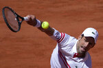 Serbia's Novak Djokovic serves to Stefanos Tsitsipas of Greece during their final match of the French Open tennis tournament at the Roland Garros stadium Sunday, June 13, 2021 in Paris. (AP Photo/Christophe Ena)