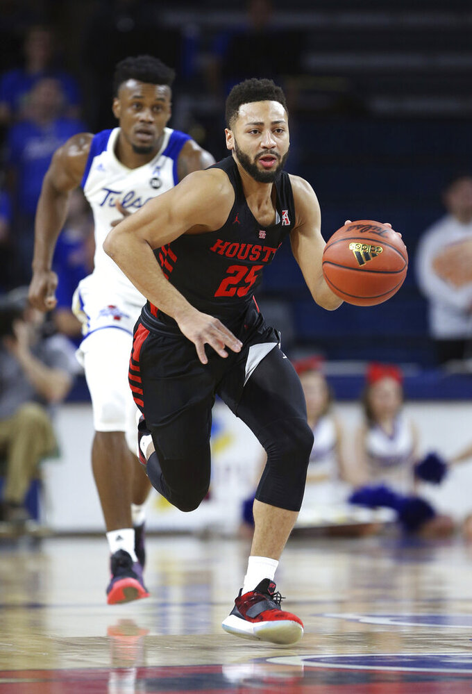 ouston's Galen Robinson (25) brings the ball downcourt on a fast break during the first half of an NCAA college basketball game against Tulsa in Tulsa, Okla., Sunday, Jan. 27, 2019. (AP Photo/Dave Crenshaw)