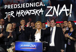 Incumbent president and presidential candidate Kolinda Grabar Kitarovic, center, addresses to her supporters in Zagreb, Croatia, Sunday, Jan. 5, 2020. A leftist Zoran Milanovic challenger won Croatia's highly contested presidential election on Sunday, beating a conservative incumbent — a rare victory by a liberal in recent votes in Central Europe. (AP Photo/Darko Vojinovic)