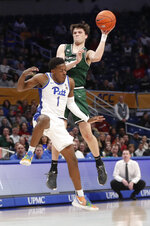 Binghamton's George Tinsley, top, passes the ball as Pittsburgh's Xavier Johnson (1) defends during the first half of an NCAA college basketball game Friday, Dec. 20, 2019, in Pittsburgh. (AP Photo/Keith Srakocic)