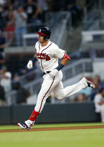 Atlanta Braves' rookie Austin Riley rounds the bases after hitting a home run in the fourth inning of a baseball game against the St. Louis Cardinals Wednesday, May 15, 2019, in Atlanta. It was Riley's first Major League hit. (AP Photo/John Bazemore)