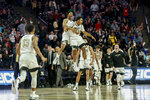 Wake Forest guards Jahcobi Neath, center left, and Brandon Childress celebrate as Wake Forest defeats Xavier in an NCAA college basketball game in Winston-Salem, N.C., Saturday, Dec. 14, 2019. (AP Photo/Nell Redmond)