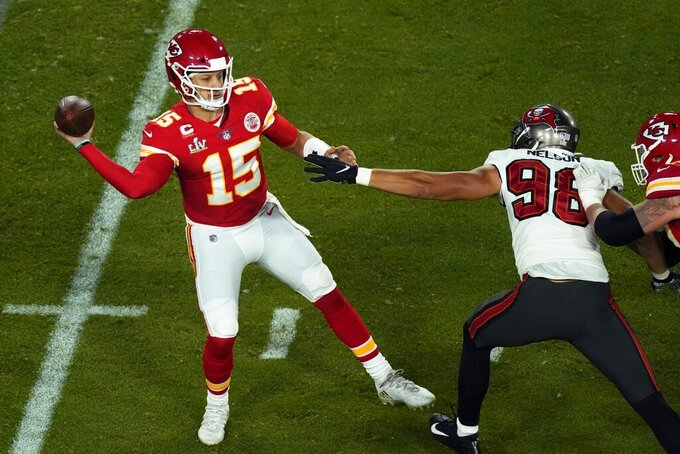 Kansas City Chiefs quarterback Patrick Mahomes (15) looks to throw while being pressured by Tampa Bay Buccaneers' Anthony Nelson (98) during the first half of the NFL Super Bowl 55 football game Sunday, Feb. 7, 2021, in Tampa, Fla. (AP Photo/Charlie Riedel)