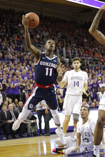 Gonzaga's Joel Ayayi (11) shoots against Washington in the first half of an NCAA college basketball game Sunday, Dec. 8, 2019, in Seattle. (AP Photo/Elaine Thompson)
