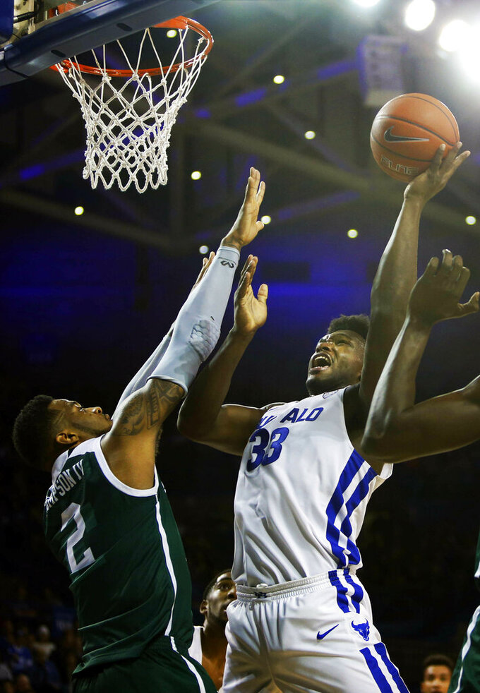 Buffalo forward Nick Perkins (33) goes up against Eastern Michigan center James Thompson IV (2) during the second half of an NCAA college basketball game, Friday, Jan. 18, 2019, in Buffalo N.Y. (AP Photo/Jeffrey T. Barnes)