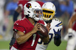 Arizona Cardinals quarterback Kyler Murray (1) scrambles against the Los Angeles Chargers during the first half of an NFL preseason football game, Thursday, Aug. 8, 2019, in Glendale, Ariz. (AP Photo/Ross D. Franklin)
