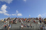 Fans watch from the grandstand while remaining socially distanced during an IndyCar auto race Sunday, Oct. 25, 2020, in St. Petersburg, Fla. (AP Photo/Mike Carlson)