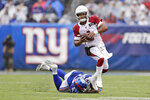 Arizona Cardinals quarterback Kyler Murray, top, evades a tackle by New York Giants' Oshane Ximines, bottom, during the first half of an NFL football game, Sunday, Oct. 20, 2019, in East Rutherford, N.J. (AP Photo/Adam Hunger)