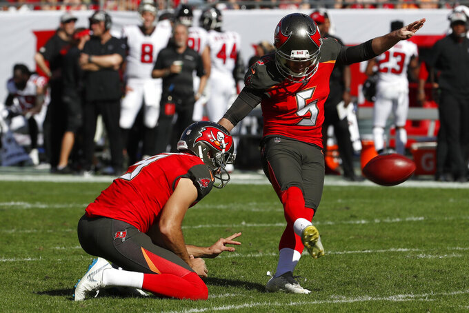 FILE - In this Dec. 30, 2018, file photo, then-Tampa Bay Buccaneers' Cairo Santos (5) kicks a field goal against the Atlanta Falcons during the first half of an NFL football game, in Tampa, Fla. The Tennessee Titans have placed kicker Ryan Succop on injured reserve and have added veteran Cairo Santos to take over for him. Succop hadn't missed a game in five seasons with the Titans but had been recovering from offseason knee surgery. (AP Photo/Mark LoMoglio, File)