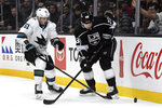 San Jose Sharks defenseman Radim Simek (51) and Los Angeles Kings right wing Dustin Brown (23) go for the puck during the second period of an NHL hockey game, Monday, Nov. 25, 2019, in Los Angeles. (AP Photo/Michael Owen Baker)