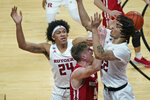 Rutgers' Ron Harper Jr., left, and Caleb McConnell, right, pressure Wisconsin's Tyler Wahl during the first half of an NCAA college basketball game Friday, Jan. 15, 2021, in Piscataway, N.J. (AP Photo/Seth Wenig)