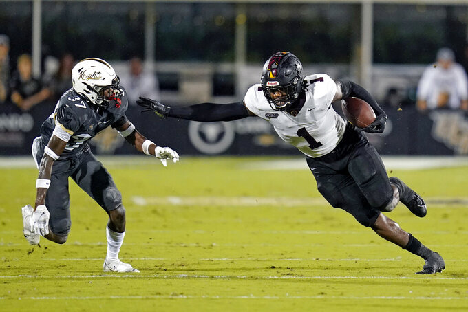 Bethune-Cookman tight end Kemari Averett (1) makes a move to get past Central Florida defensive back Quadric Bullard (37) during the first half of an NCAA college football game Saturday, Sept. 11, 2021, in Orlando, Fla. (AP Photo/John Raoux)