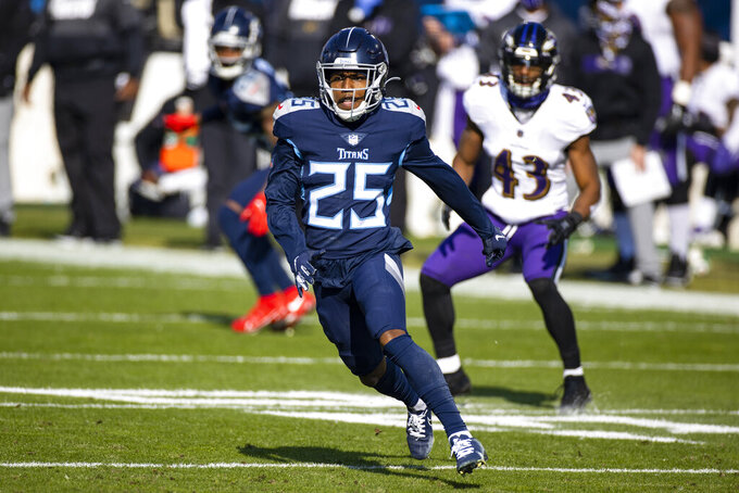 FILE - Tennessee Titans cornerback Adoree' Jackson (25) rushes against the Baltimore Ravens during the first quarter of an NFL wild-card playoff football game in Nashville, Tenn., in this Sunday, Jan. 10, 2021, file photo. The New York Giants gave it the old college try in signing cornerback Adoree Jackson and filling another glaring need in free agency. Hours after signing a three-year, $39 million contract, Jackson said he felt like a college recruit they way players and coaches pumped up the team in trying to get him to join the Giants. (AP Photo/Brett Carlsen, File)