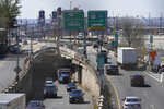 "Cars maneuver through tangle of expressways in Jersey City, N.J., Tuesday, April 6, 2021. President Joe Biden is setting about convincing America it needs his $2.3 trillion infrastructure plan, deputizing a five-member ""jobs Cabinet"" to help in the effort. But the enormity of his task is clear after Senate Minority Leader Mitch McConnell's vowed to oppose the plan ""every step of the way."" (AP Photo/Seth Wenig)"