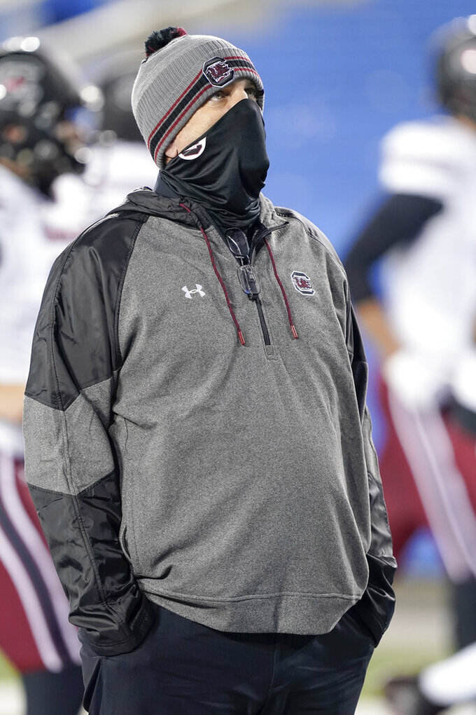 South Carolina interim head coach Mike Bobo stands on the field before an NCAA college football game against Kentucky, Saturday, Dec. 5, 2020, in Lexington, Ky. (AP Photo/Bryan Woolston)