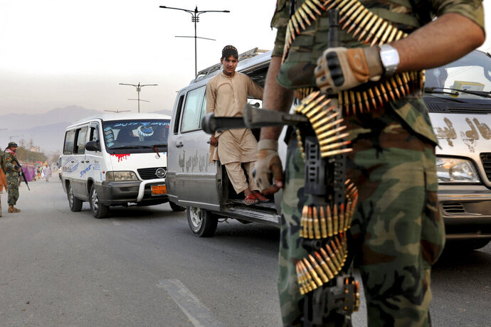 In this Tuesday, Sept. 24, 2019 photo, Afghan National Army soldiers stand guard at a checkpoint ahead of presidential elections scheduled for Sept. 28, in Kabul, Afghanistan. Afghans facing down Taliban threats are torn between fear, frustration and sense of duty as they decide whether to go to the polls Saturday to choose a new president. But the security preparations have been elaborate. (AP Photo/Ebrahim Noroozi)