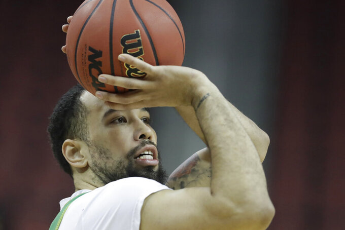 Oregon's Paul White shoots during practice for the NCAA men's college basketball tournament, Wednesday, March 27, 2019, in Louisville, Ky. (AP Photo/Darron Cummings)