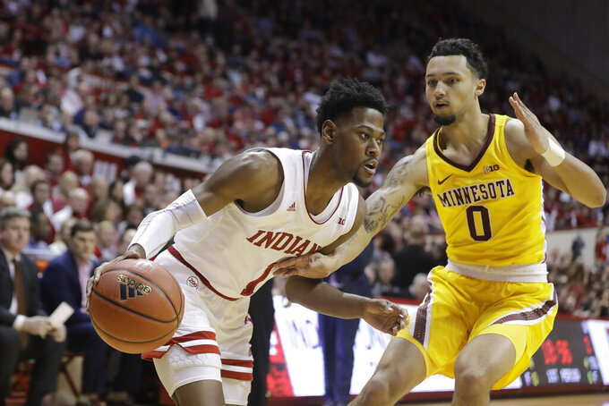 Indiana's Al Durham (1) goes to the basket against Minnesota's Payton Willis (0) during the first half of an NCAA college basketball game Wednesday, March 4, 2020, in Bloomington, Ind. (AP Photo/Darron Cummings)