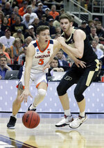 Virginia's Kyle Guy (5) goes to the basket against Purdue's Ryan Cline during the first half of the men's NCAA Tournament college basketball South Regional final game, Saturday, March 30, 2019, in Louisville, Ky. (AP Photo/Michael Conroy)