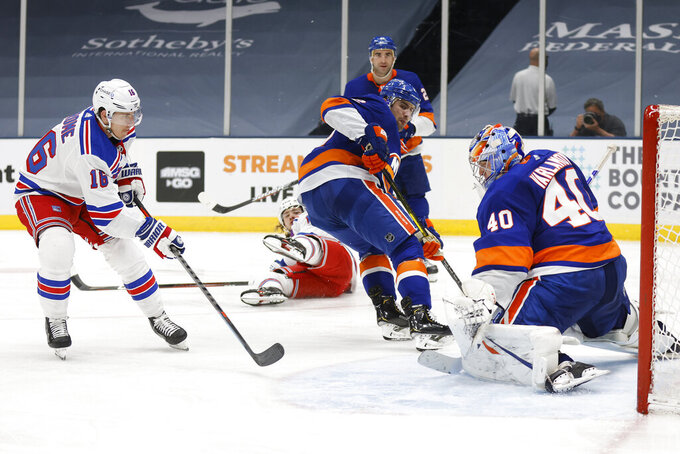 New York Islanders goalie Semyon Varlamov (40), of Russia, saves a shot from New York Rangers' Ryan Strome (16) during the third period of an NHL hockey game Friday, April 9, 2021, in Uniondale, N.Y. (AP Photo/Jason DeCrow)