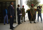 Ethiopian Prime Minister Abiy Ahmed , left, waits for the arrival of US Secretary of State Mike Pompeo at the Prime Minister's office in Addis Ababa, Tuesday Feb. 18, 2020. Pompeo's visit to Africa is the first by a Cabinet official in 18 months. (Andrew Caballero-Reynolds/Pool via AP)
