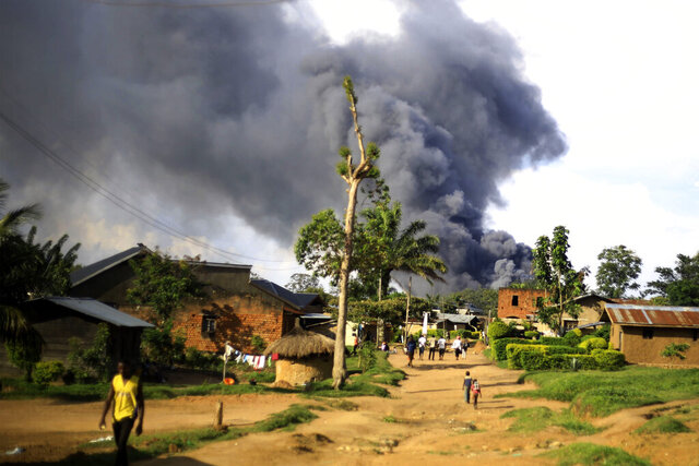 Smoke from the United Nations compound rises in Beni, Democratic Republic of Congo, Monday, Nov. 25, 2019. Angry residents of this eastern Congo city burned the town hall and stormed the UN peacekeeping mission, known as MONUSCO, after Allied Democratic Forces rebels killed eight people and kidnapped nine overnight. (AP Photo/Al-hadji Kudra Maliro)