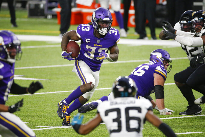 Minnesota Vikings running back Dalvin Cook (33) runs up field during overtime in an NFL football game against the Jacksonville Jaguars, Sunday, Dec. 6, 2020, in Minneapolis. The Vikings won 27-24. (AP Photo/Bruce Kluckhohn)