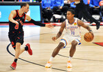Toronto Raptors' Malachi Flynn, left, defends Oklahoma City Thunder's Theo Maledon, right, during the third quarter of a basketball game Sunday, April 18, 2021, in St. Petersburg, Fla. (AP Photo/Steve Nesius)