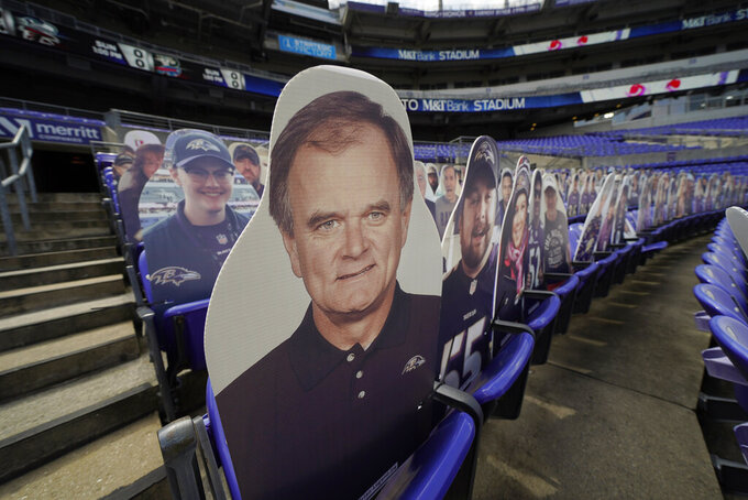 A cutout of former Baltimore Raves head coach Brian Billlick is seen in the stands before and NFL football game against the Cleveland Browns, Sunday, Sept. 13, 2020, in Baltimore, MD. (AP Photo/Julio Cortez)