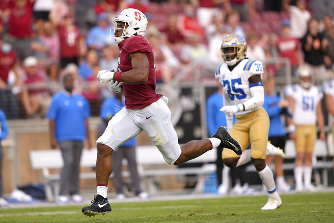 Stanford wide receiver Elijah Higgins (6) runs for a touchdown after making the catch against the UCLA during the second half of an NCAA college football game Saturday, Sept. 25, 2021, in Stanford, Calif. (AP Photo/Tony Avelar)