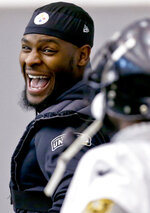 Pittsburgh Steelers running back Le'Veon Bell (26), left, has a laugh with running back Stevan Ridley during an NFL football practice, Thursday, Jan. 11, 2018, in Pittsburgh. The Steelers host the Jacksonville Jaguars in a divisional playoff on Sunday. (AP Photo/Keith Srakocic)